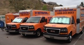 Commercial Property Damage Trucks At Job Site